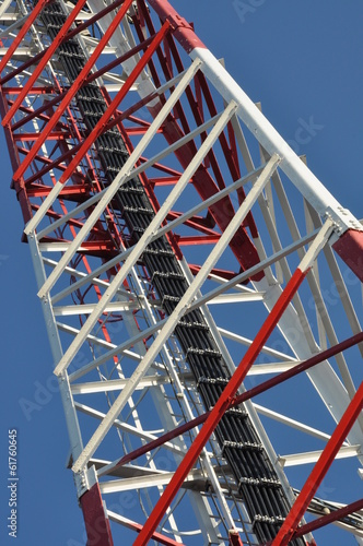 Construction of a telecommunications tower against the blu sky