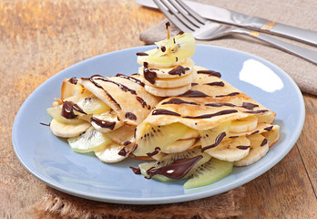 Pancakes with fruit with chocolate syrup
