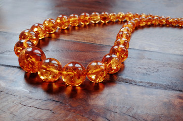 Amber necklace on dark wood
