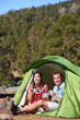 Camping people - couple eating in tent happy