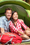 Couple camping in tent happy in romance