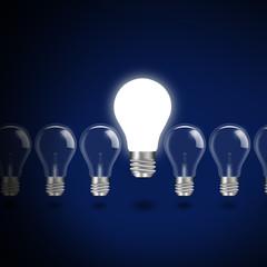 idea concept with light bulbs on a blue background