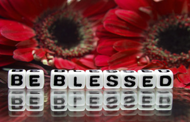 Be blessed message with red flowers