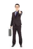 happy businessman holding briefcase and  thumb up
