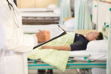 doctor records patients medical situation