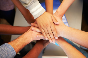 Hands From Young People Of Different Races Joined Together