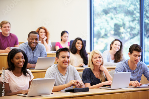 Students Using Laptops And Digital Tablets In Lecture - 61764603