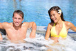 Wellness Spa - couple relaxing in hot tub whirlpool