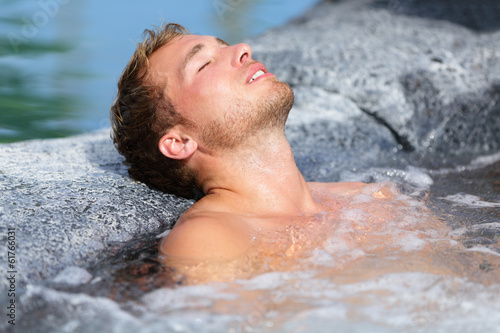 Wellness Spa - man relaxing in hot tub whirlpool