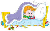 Little boy playing with a toy car in his bed