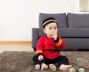 Little boy bite toy block