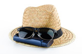 Hat , sunglasses , body lotion isolated on white background