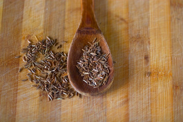 caraway seeds in a wooden spoon