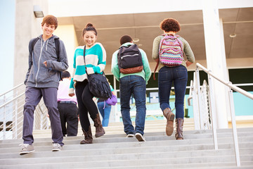 High School Pupils On Steps Outside Building