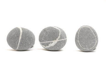 Row of Three pebbles on white