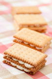 Sandwich cookies on pink tablecloth