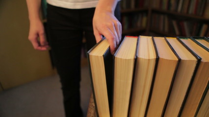Collecting books in a library, HD 1080p