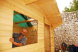 Man Constructing Wooden Cabin