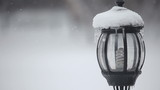 Lantern covered with snow. Rack focus.