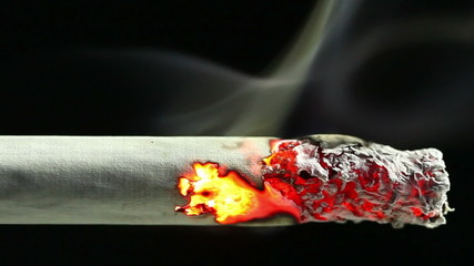 Closeup view of burning cigarette in time-lapse, HD 1080