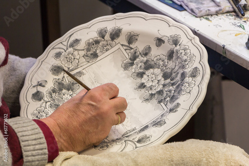 Painting of a traditional Delft blue plate