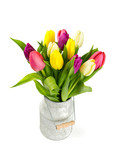 colorful tulips in a milk can