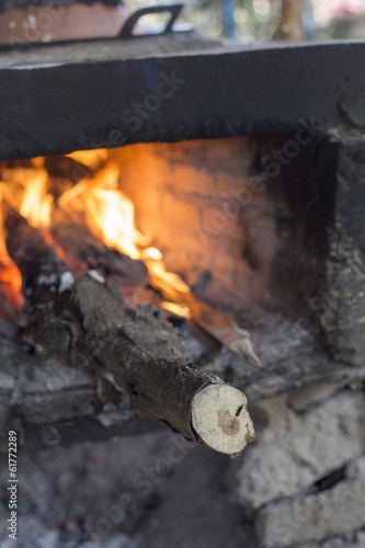 firewood in hot stove