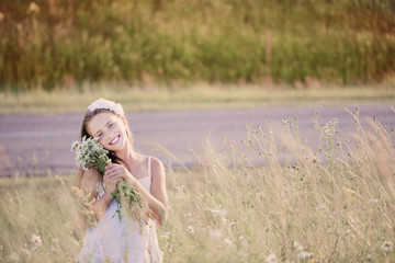 child girl at chamomile field