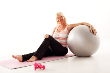 Woman relaxing after pilates training.