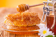 Still life of honey on wooden table