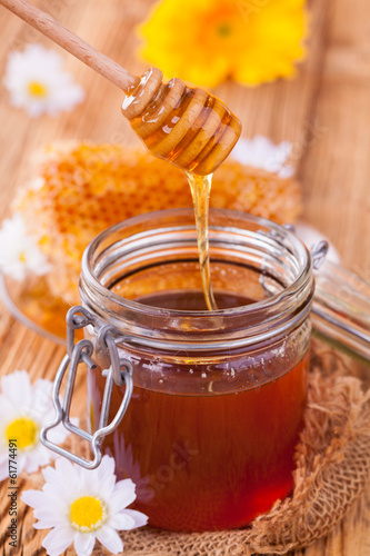 Still life of honey on wooden table