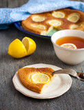 Slice of lemon pie with fresh lemons
