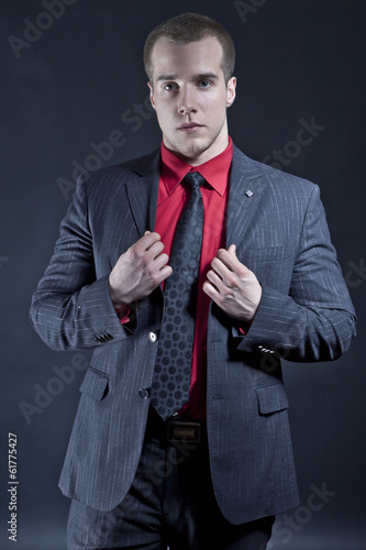 Handsome businessman on the black background
