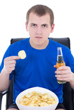 man in blue watching tv with chips and beer isolated on white