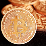 Photo Golden Bitcoins (new virtual money ) on a black background