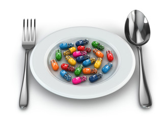 Dietary supplements. Variety pills. Vitamin capsules on plate.