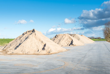 Piles of sand and gravel