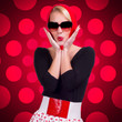 Pin-up girl over red polka-dot background