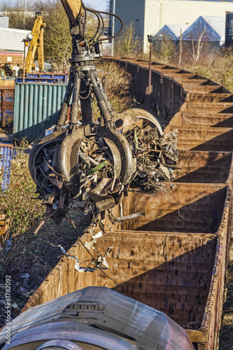 Scrap metal being loaded onto a train