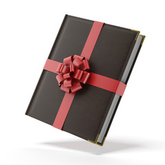 Book wrapped with a red ribbon