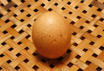 egg on wooden basket