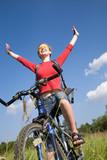 happy young woman on bike