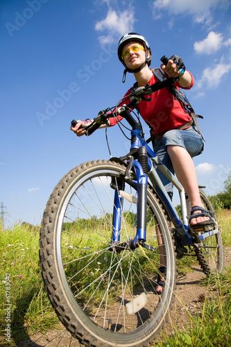 cyclist on grass