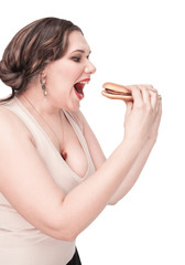 Plus size woman eating hamburger