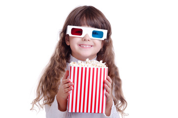happy girl eating popcorn and wearing glasses