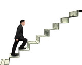 businessman walking on money stairs