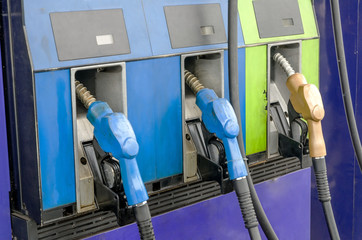 Four petrol pumps, close up