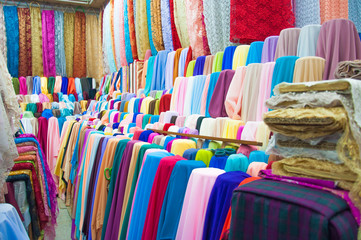 many reels of textile in the market, colorful, background