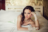wedding. Beautiful woman lying on the bed in her bedroom