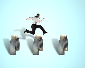 businessman jumping over euro obstacles